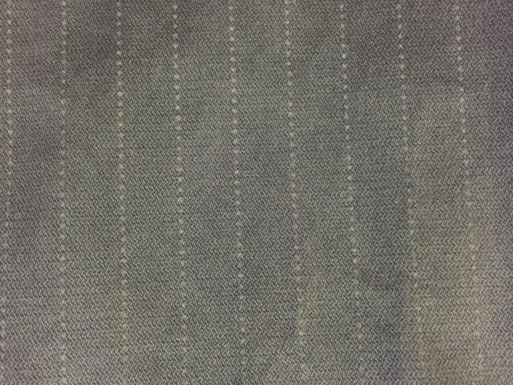 Faded grey/blue with stitched pattern and dotted lines running vertically