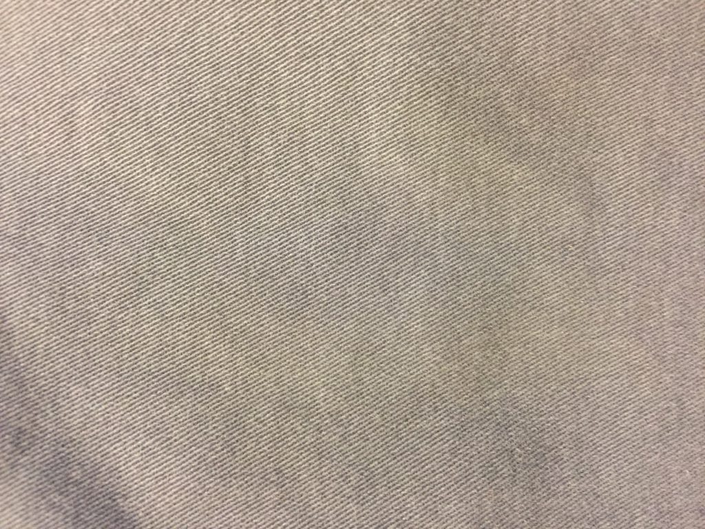 Light grey fabric close up with diagonal lines