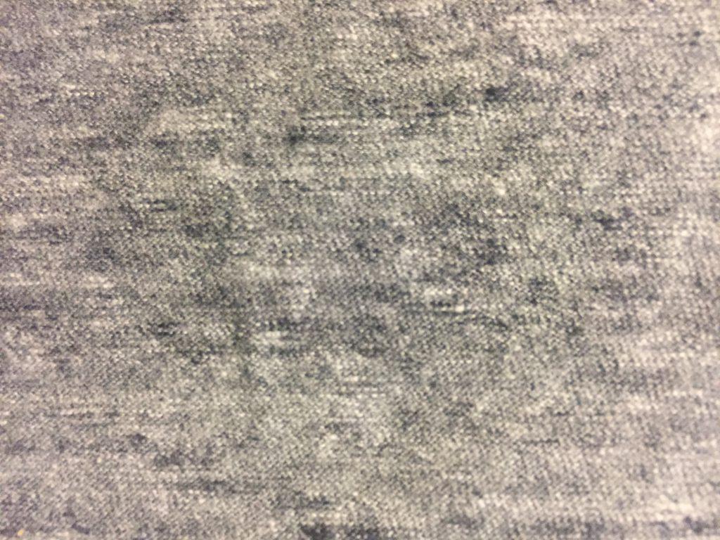 Light grey jersey fabric close up texture