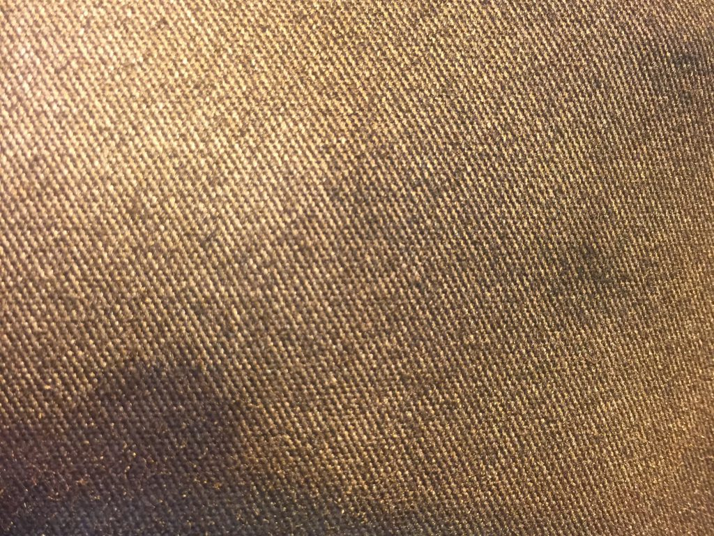 Close up of golden fabric with diagonal lines
