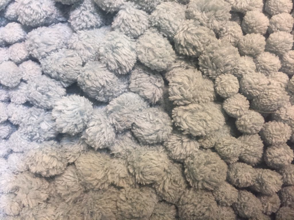 Layered pale blue balls with furry texture.