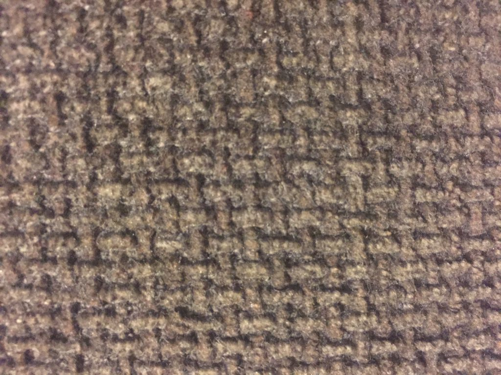 Close up of deep brown fabric texture