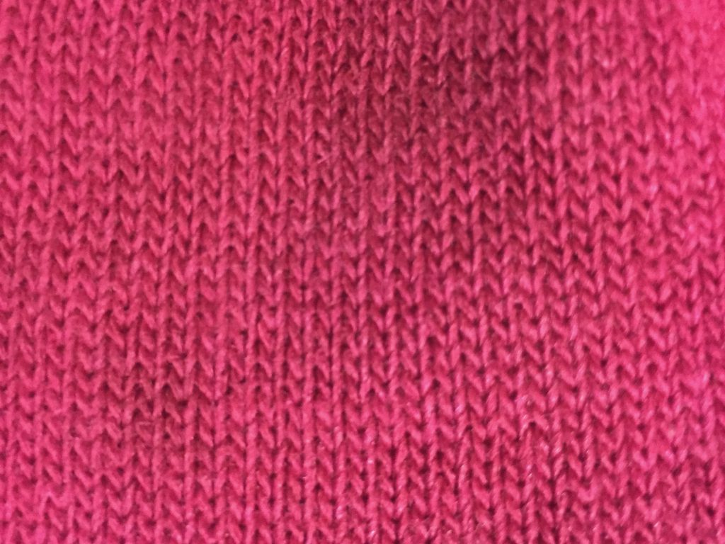 Loosely knitted fabric from a pink glove