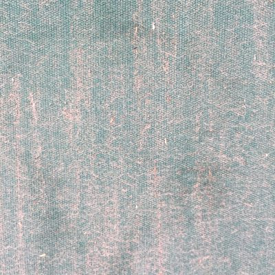 Weather worn teal fabric featuring pattern