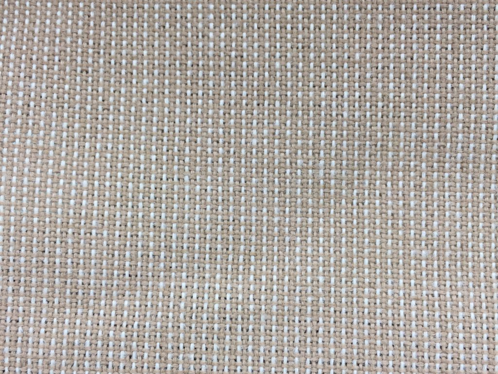 Loosely woven light brown and white threaded fabric