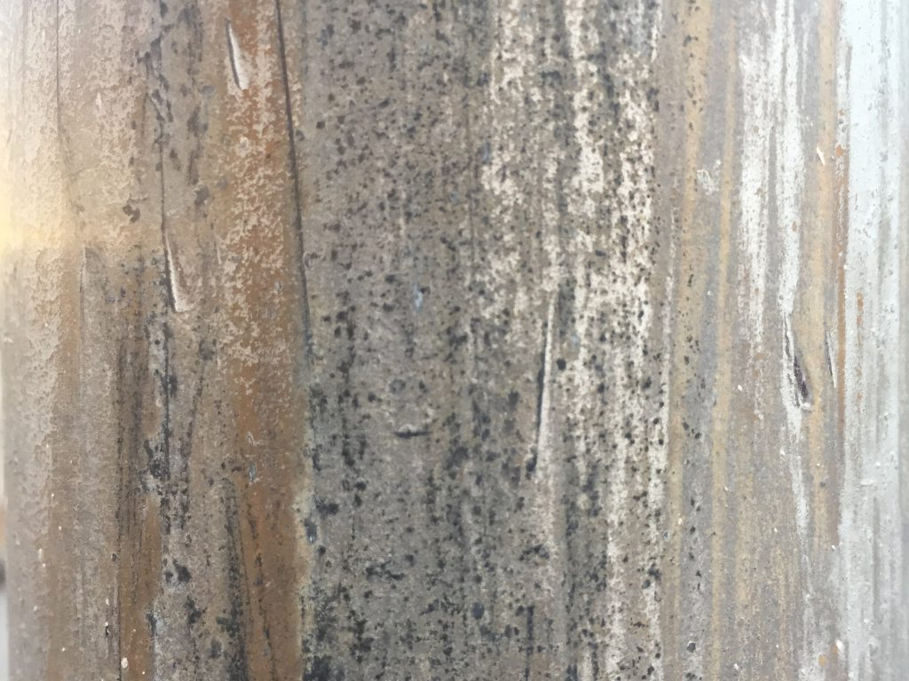 Metallic vertical lines of corrosion and rust texture