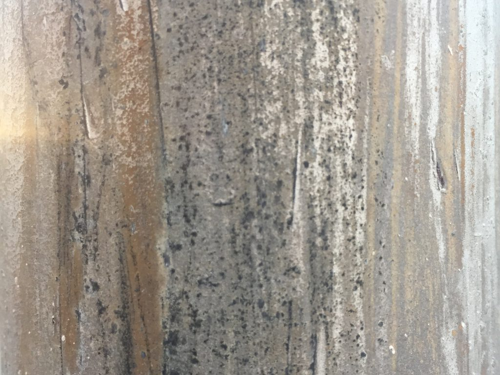 Grungy metal with rust, scratches, and dark spots