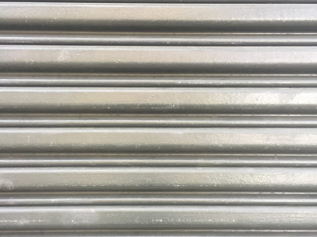 Textured metal wall with horizontal folds