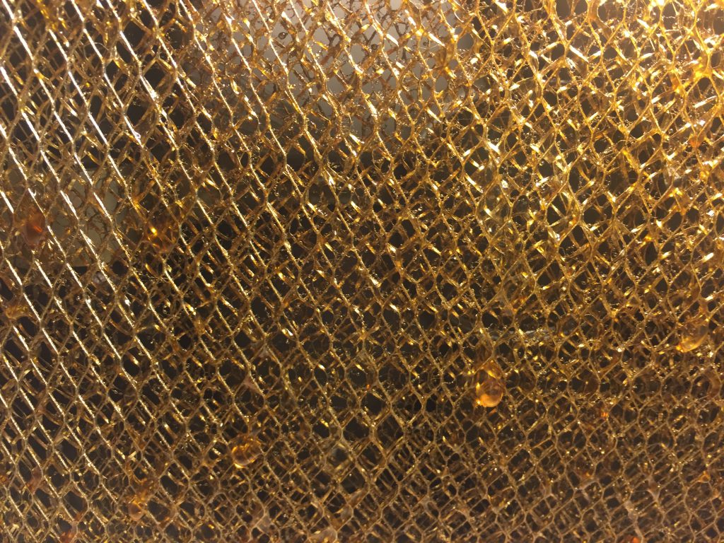 Layers of brass mesh with golden sap