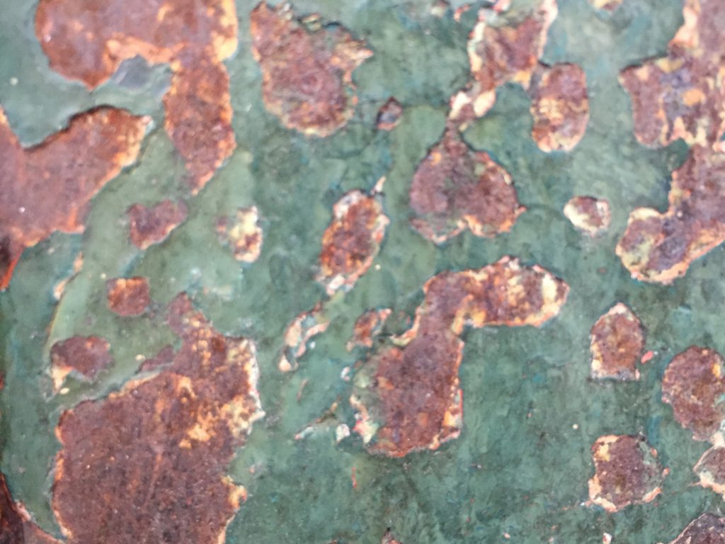 Dark green scuffed paint with rusty metal