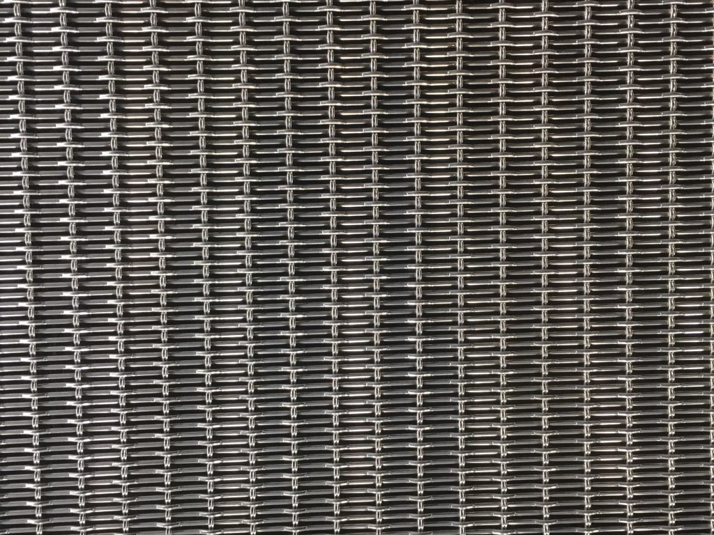Wide shot of metal grid featuring silver and black