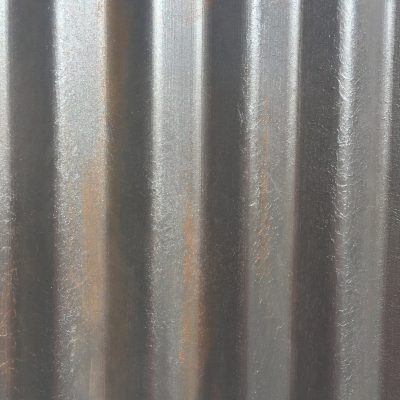 Dark rust brown and silver wall with ridges