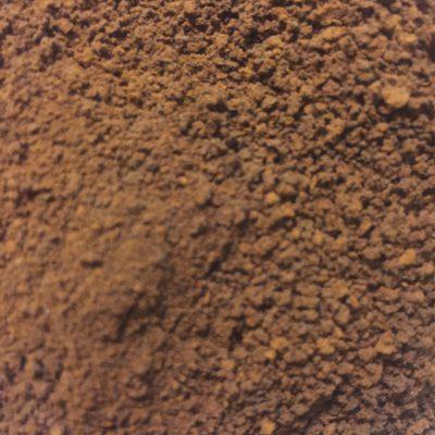 Dark brown coffee grounds close up