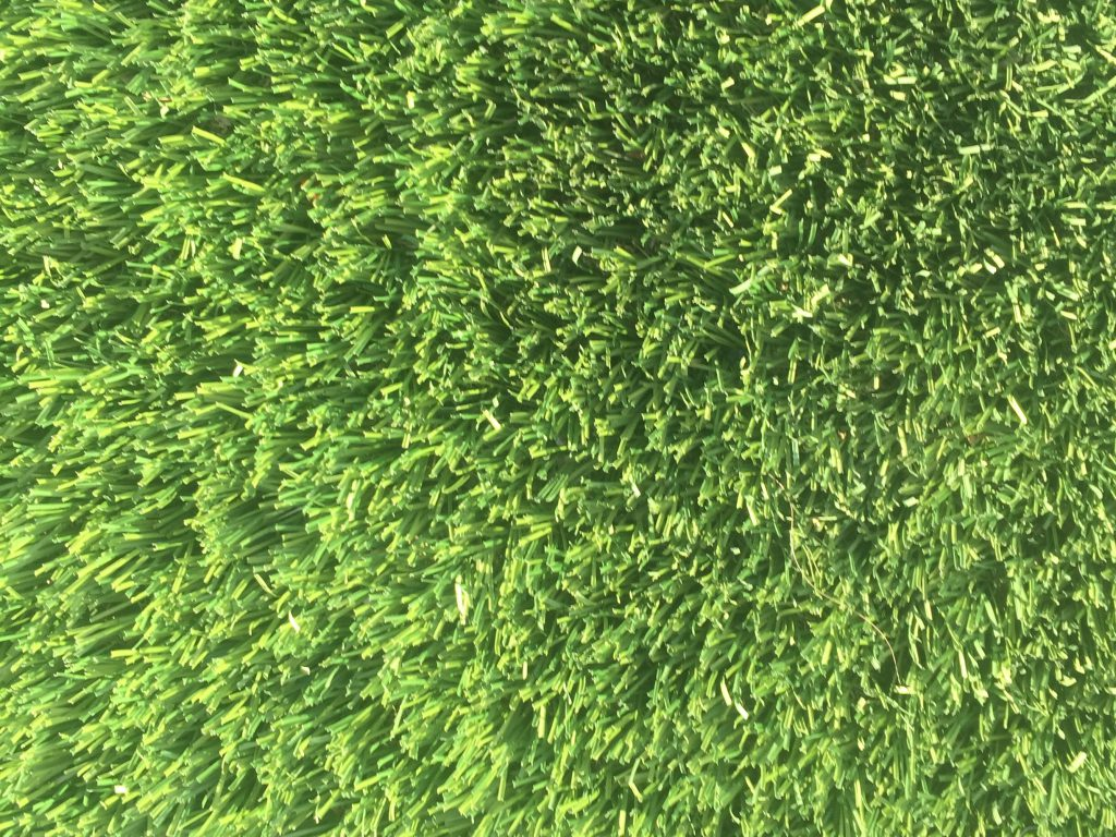 Bright green blades of astroturf grass