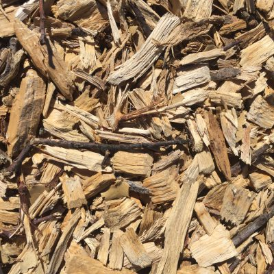 Mulch bed with light brown chunks of wood