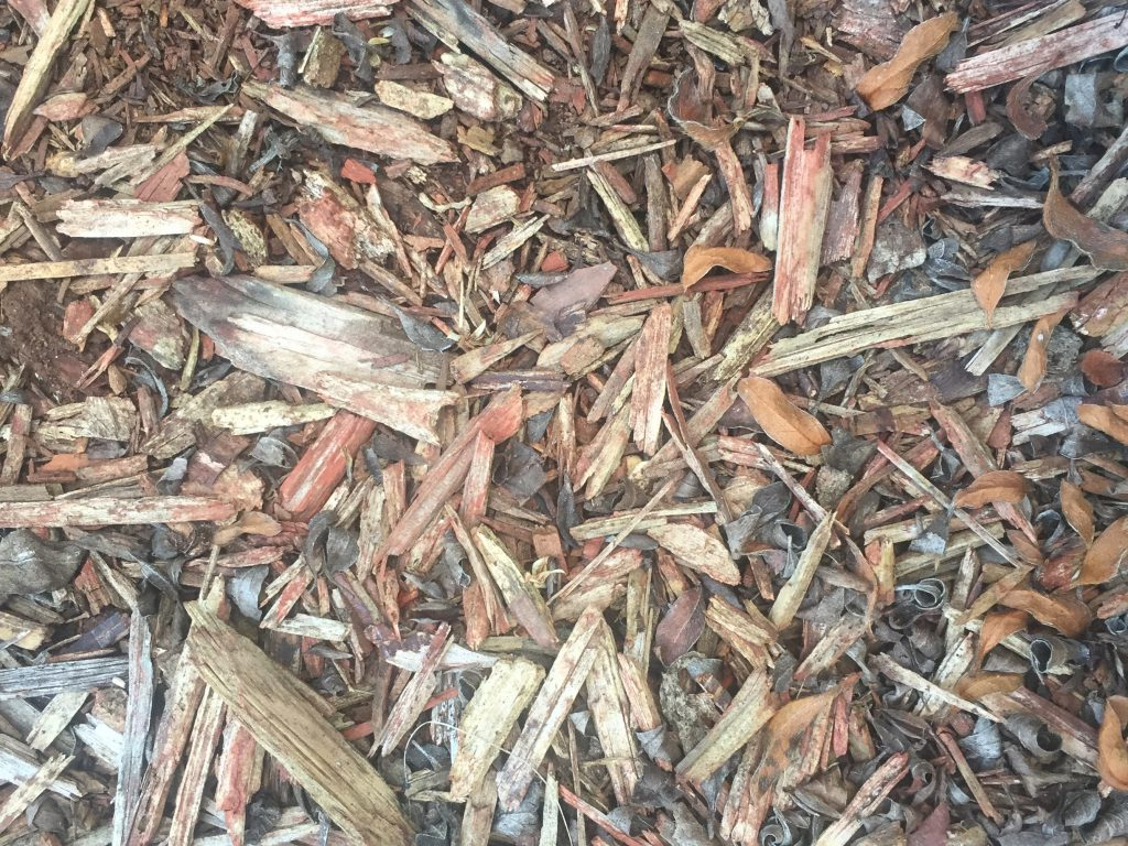 Pile of mulch with a variety of colors