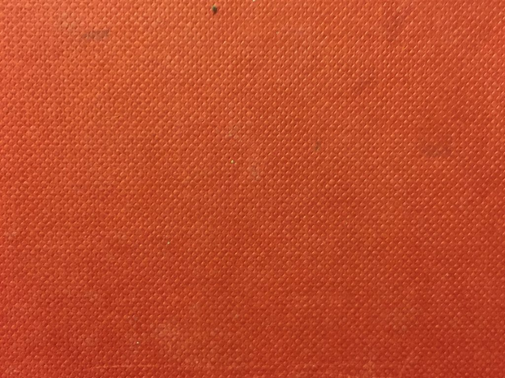 Book cover with pattern over gradient of orange