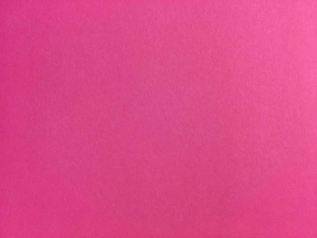 Bright pink paper texture with glossy spots