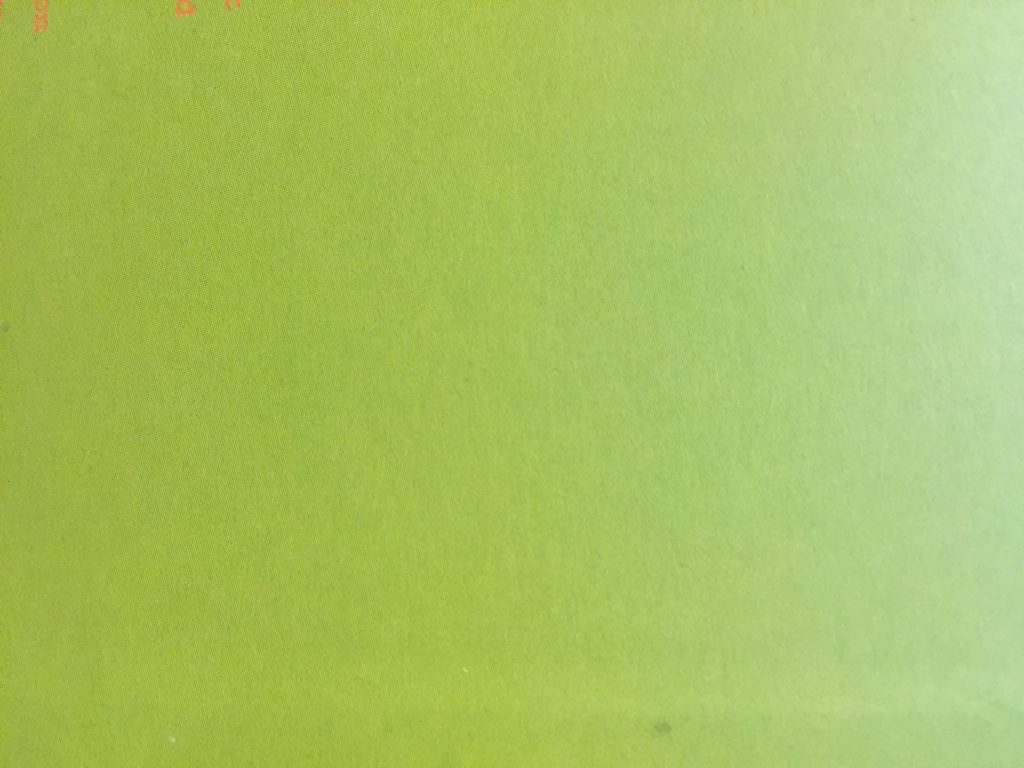 Paper featuring lime green color and fine grain texture