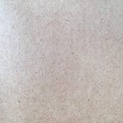 Speckled paper texture with lots of grain and hints of light pink