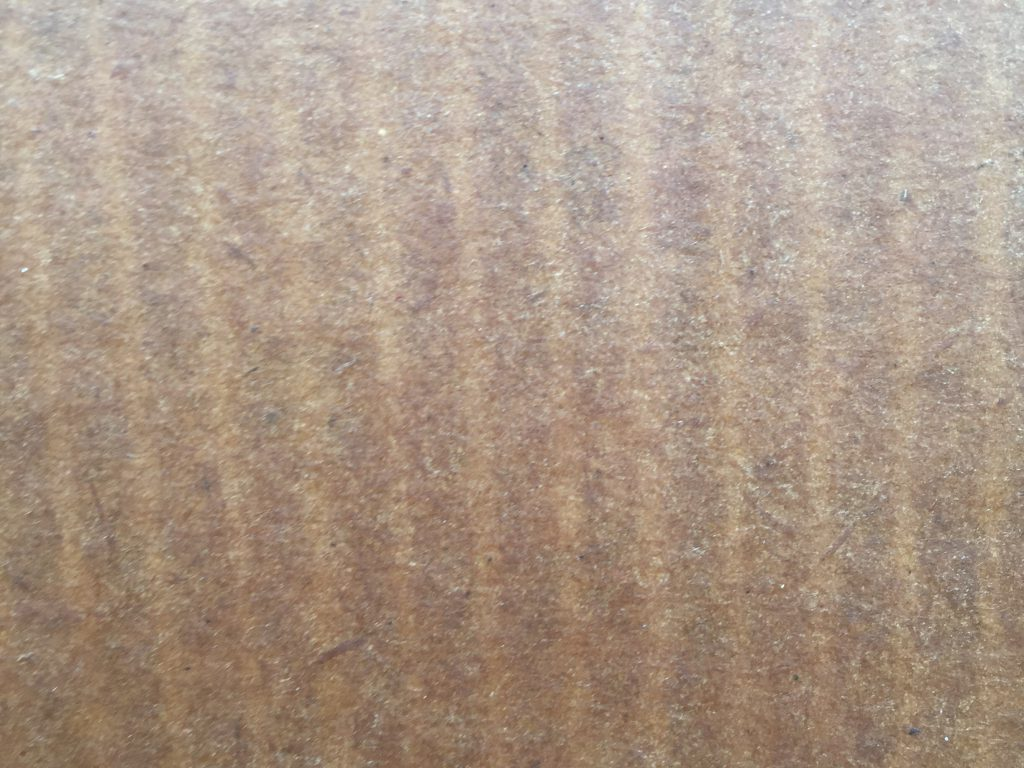 Brown cardboard with vertical lines and light waxy gloss