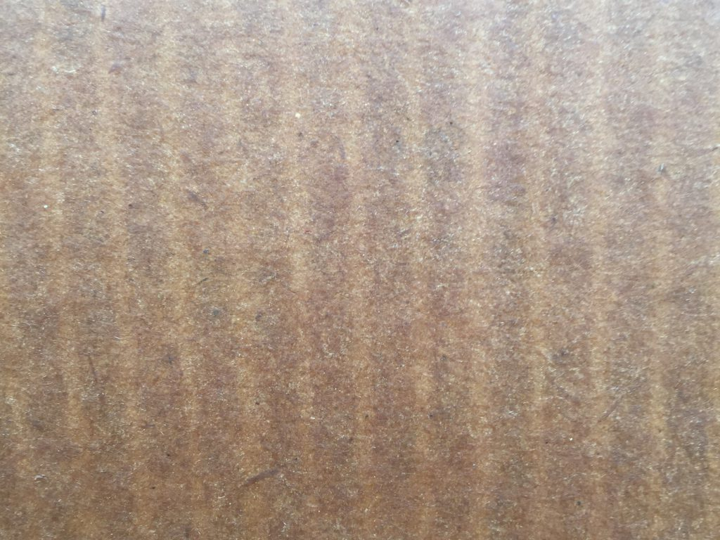 Light brown cardboard texture with light texture throughout