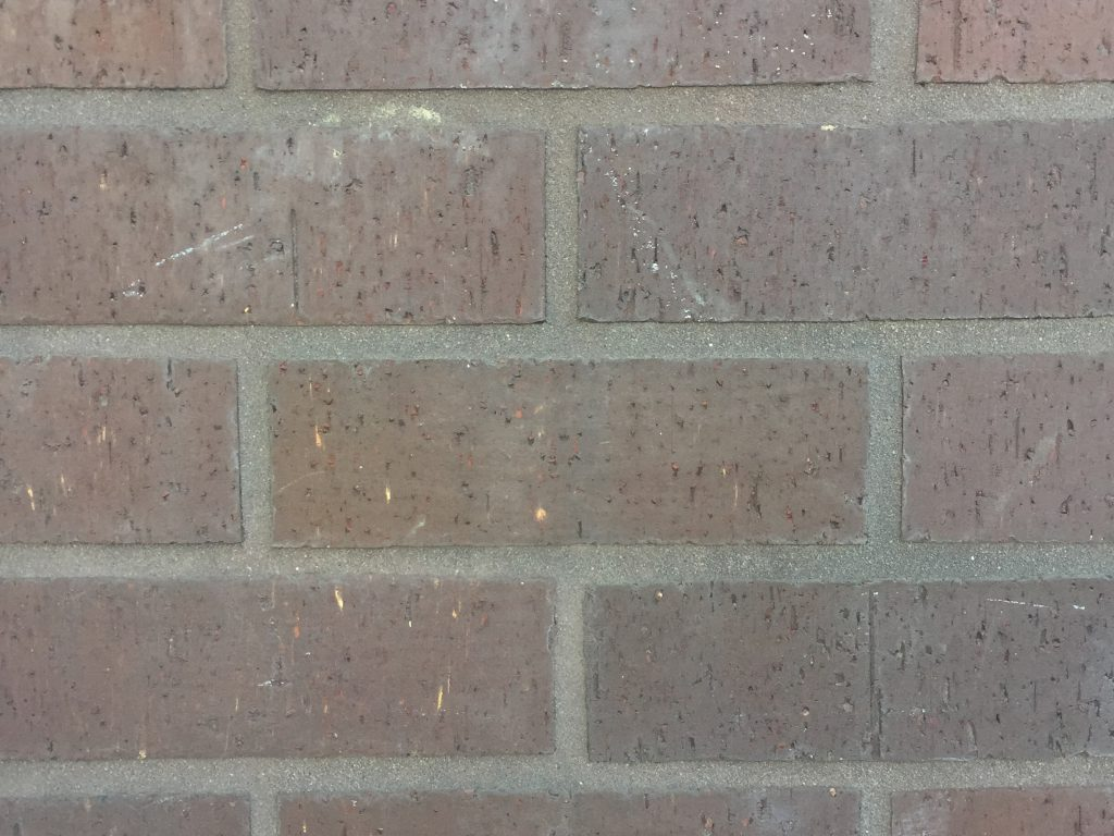 Brick wall with light grunge texture