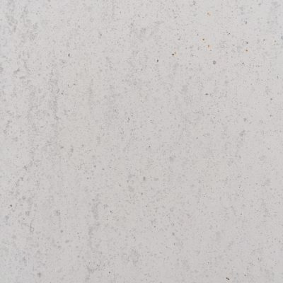 Off white concrete wall with texture and specs