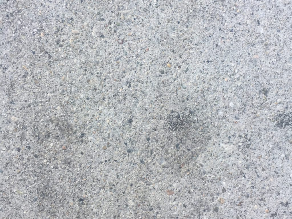 Light grey concrete with lots of small pebbles throughout