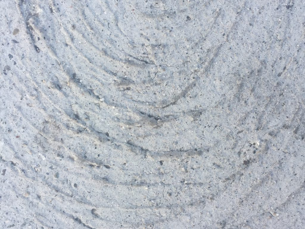 Light grey concrete swirl close up
