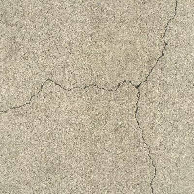 Lightly textured clean concrete with fractured crack