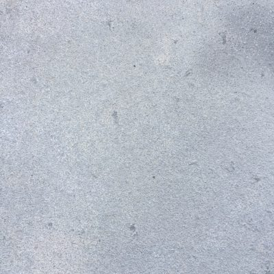 Light blue concrete wall with nice rough texture