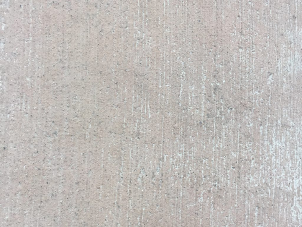 Beige concrete with vertical brush marks texture