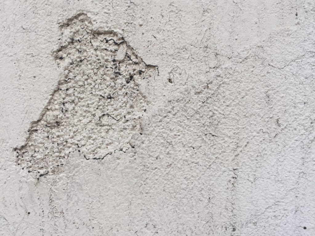 Dirty concrete wall with rough texture