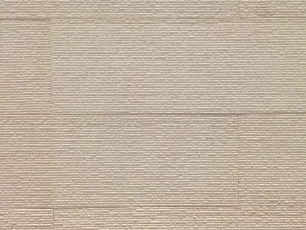 Off white flat plaster wall with horizontal texture