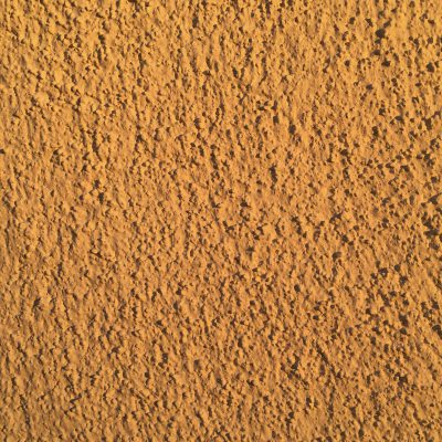 Wide shot of high contrast stucco with warm orange hue.