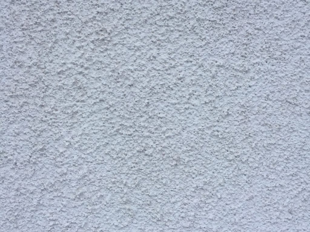 Stucco wall pattern with blue-ish hue.
