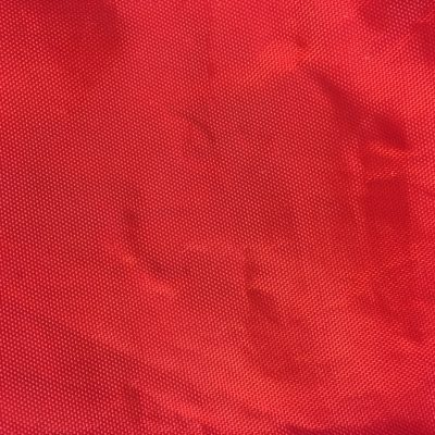 Bright red plastic bag with dotted texture