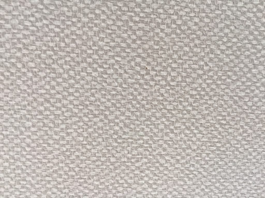 White vinyl upholstery with knit like pattern