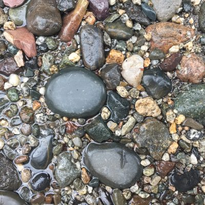 Wet Shiny Pebbles and Stones