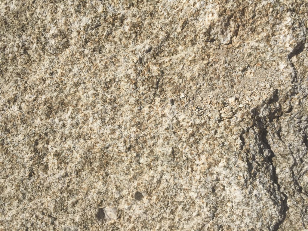 Noisy white, grey and gold rock texture