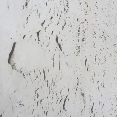 Pearl white rock wall of building exterior