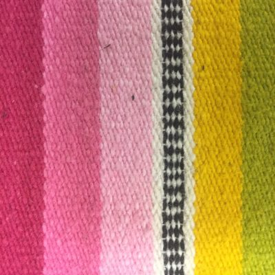 Colorful Mexican blanket with vertical bars of textured color