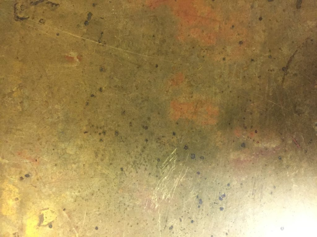Close up of dirty gold metal texture