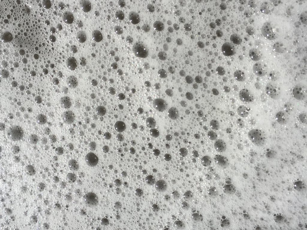 White sea foam close up with bubbles