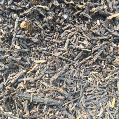 Bed of mulch with range of brown wood chunks