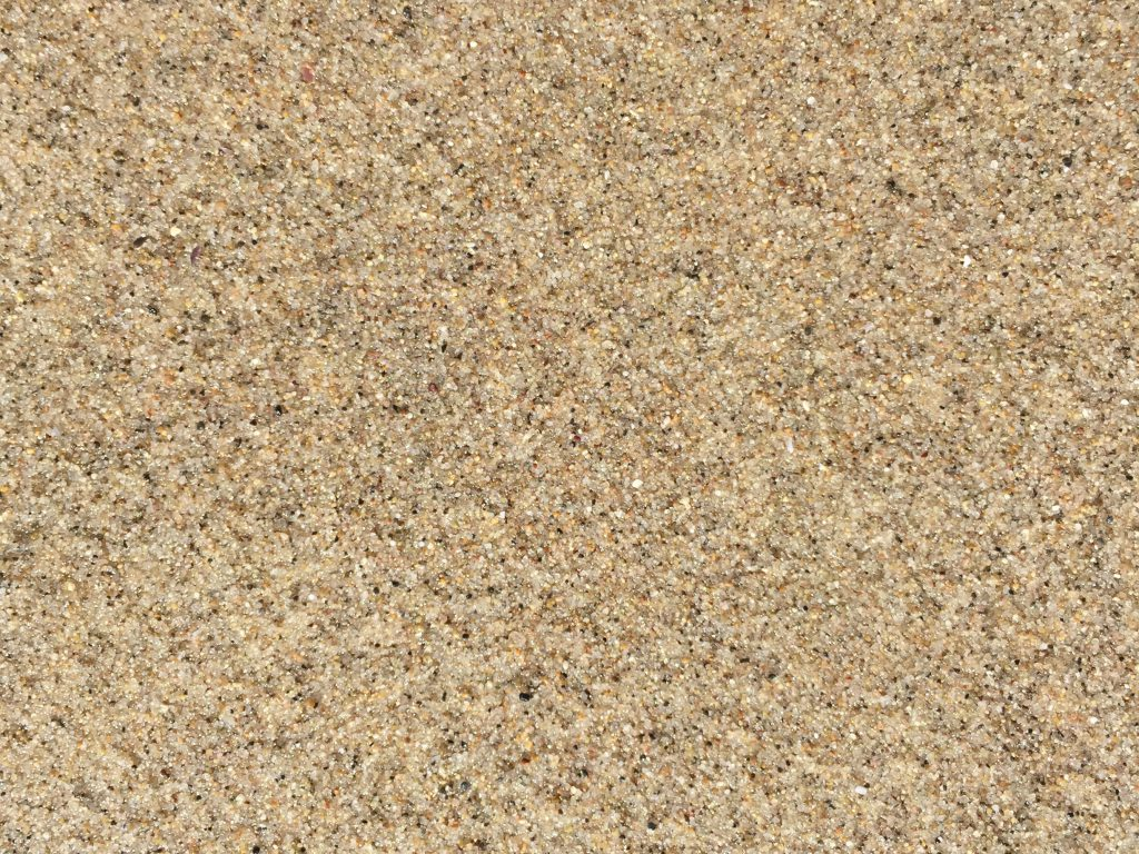 Packed down light brown sand texture