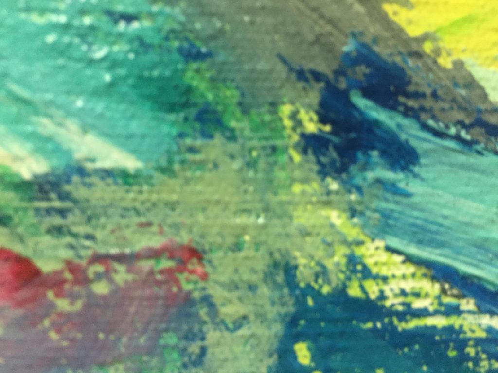 Close up of brush strokes on canvas featuring blues
