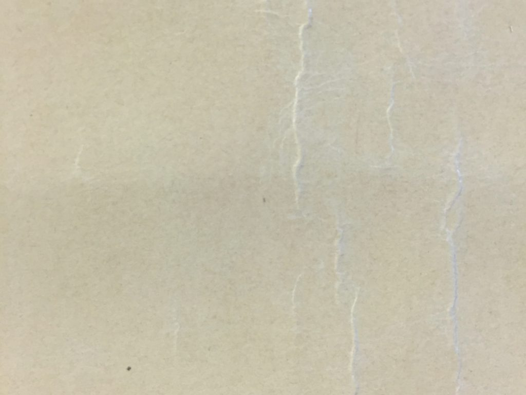 Close up of off white paper grain texture