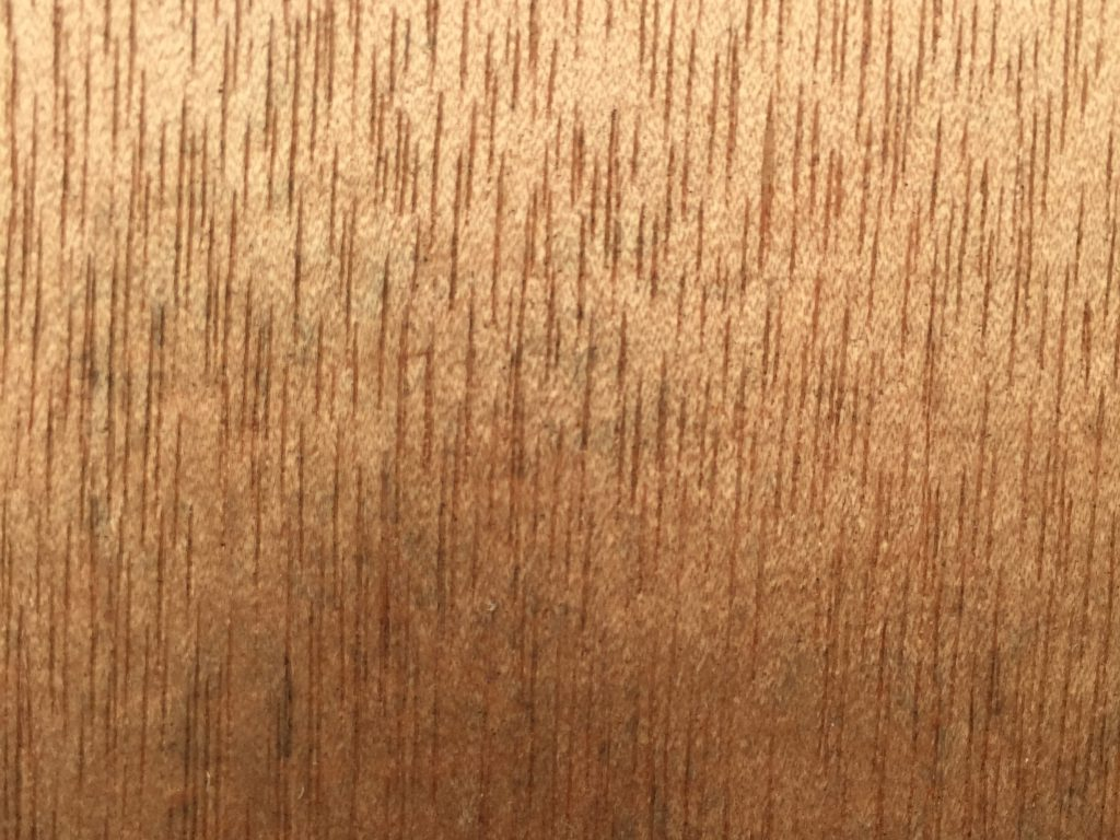 Gold wood with vertical lines of grain texture